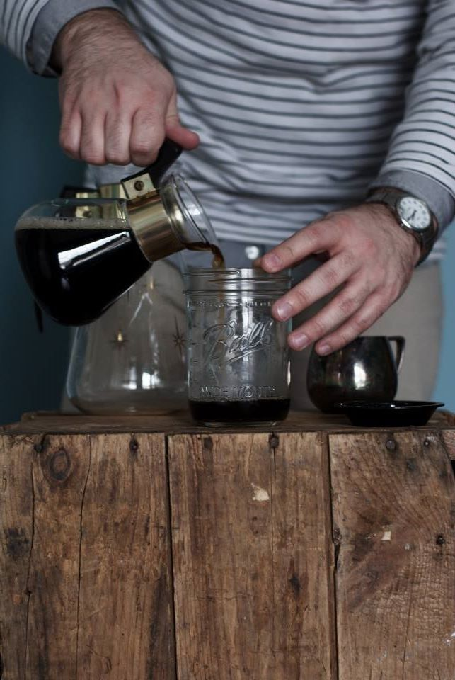 Coffee is best served in mason jars and vintage midcentury carafes.
