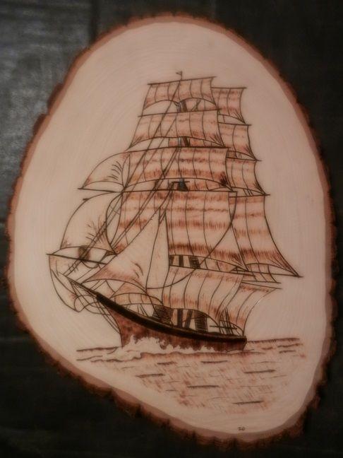 Ship wood burning art