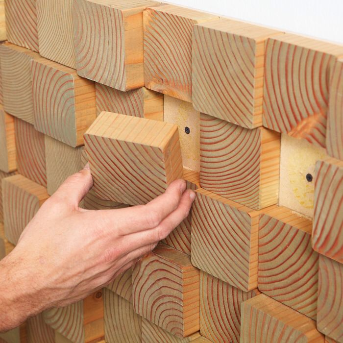 "Need a feature wall or a focal point? Buy 4 x 4 lumber, and slice into 3/4"" - 1"" pieces. Use liquid nails to affix to your wall. Stain, paint, urethane or do nothing at all."