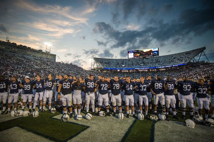 Description of . Penn State players sing their alma mater on the field after a 48-7 win at Beaver Stadium in State College, Pa., on Saturday, Sept. 20, 2014. Jeff Lautenberger — For The York Daily Record/Sunday News