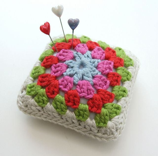 Use leftover crochet granny squares for pincushions - great idea! I love the colours.
