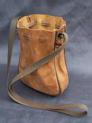 These purses are made from vegetable tanned goat skins that have been dyed using period dyes and they are made entirely by hand. The design for this purse comes from an illustration in Boccaccio's Decameron - 1430 and is a common style in the 14th and 15th centurys. It hangs from a leather cord and has a side gusset to give more room. It measures 7 x 7 inches (18 x 18 cms) when open. £30-SR