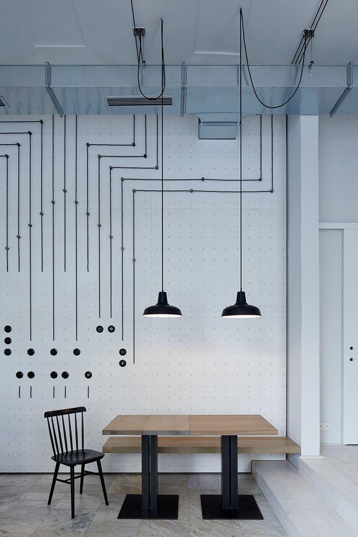 A White Minimalist Bistro In Prague | designed by Mimosa architekti and Modulora