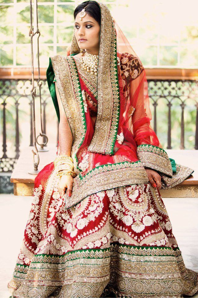 Traditional Indian bride wearing designer bridal lehenga