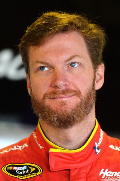 Dale Earnhardt Jr. Photos - Dale Earnhardt Jr, driver of the #88 Axalta Chevrolet, stands in the garage area during practice for the NASCAR Sprint Cup Series FireKeepers Casino 400 at Michigan International Speedway on June 11, 2016 in Brooklyn, Michigan. - Michigan International Speedway - Day 2