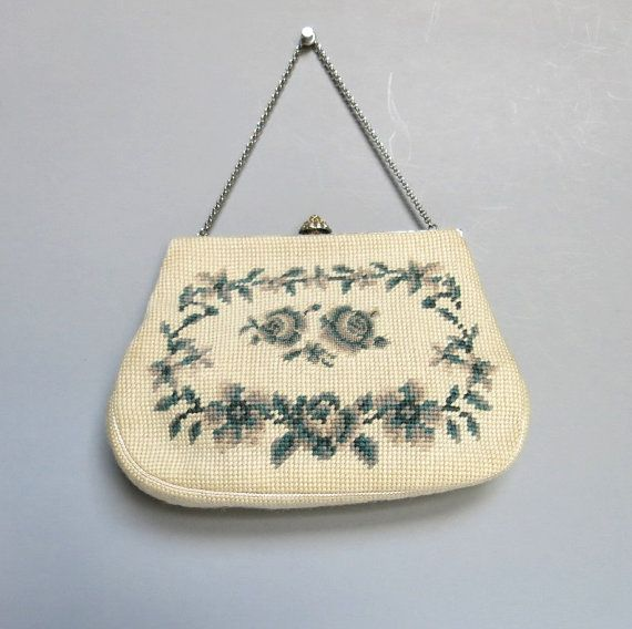 Here is a hand stitched needlepoint handbag made in the 1960s by Christine Custom Designs of Detroit. The floral design is on both sides of the bag.