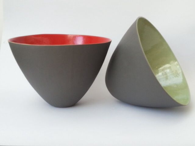 Series One Bowls with shiny, brightly coloured interiors and matt grey exteriors.