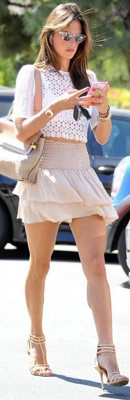 Who made Alessandra Ambrosio's nude skirt, white lace top, and beige handbag? Purse – Chloe  Skirt – ale by Alessandra  Shirt – A.L.C.  Watch – Rolex