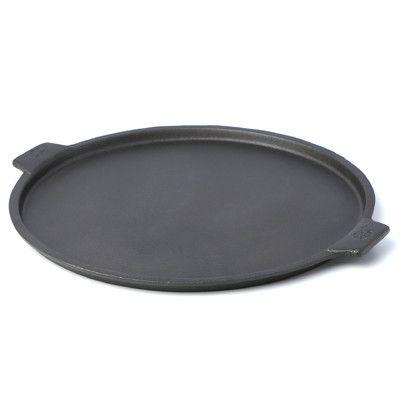 Features:  -Versatile.  -Can be used in an indoor oven or outside grill.  -Cast iron construction.  Item: -Pizza Pan.  Material: -Cast Iron.  Color: -Black.  Non-Stick: -Yes. Dimensions:  Overall Heig