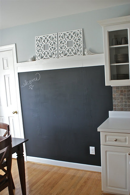 This is a nice idea, a whole wall for chalk!  The molding at the top is a great touch.