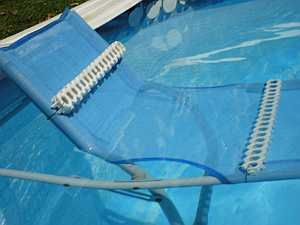 Lawn chair placed to become a dog pool ramp