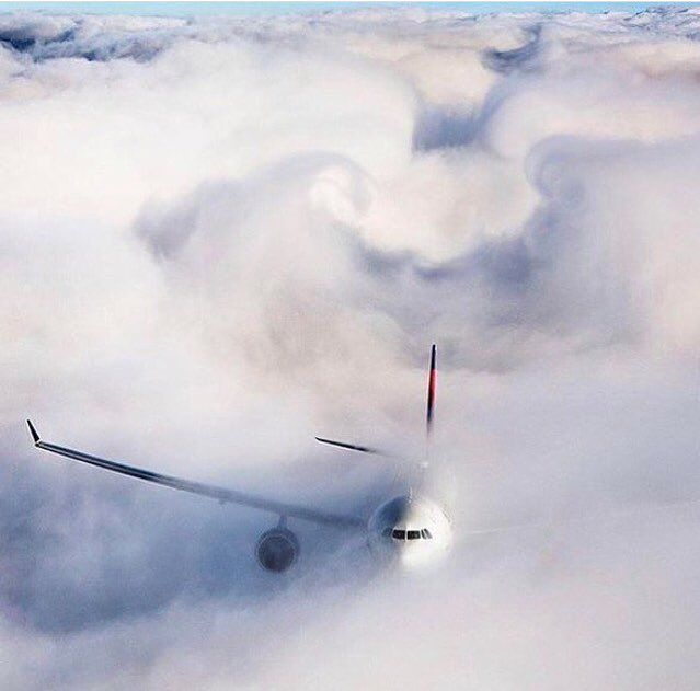 Unbelievable shot of a Delta Airbus A330 hiding in the clouds! ✈️☁️ #aviationpilotjets