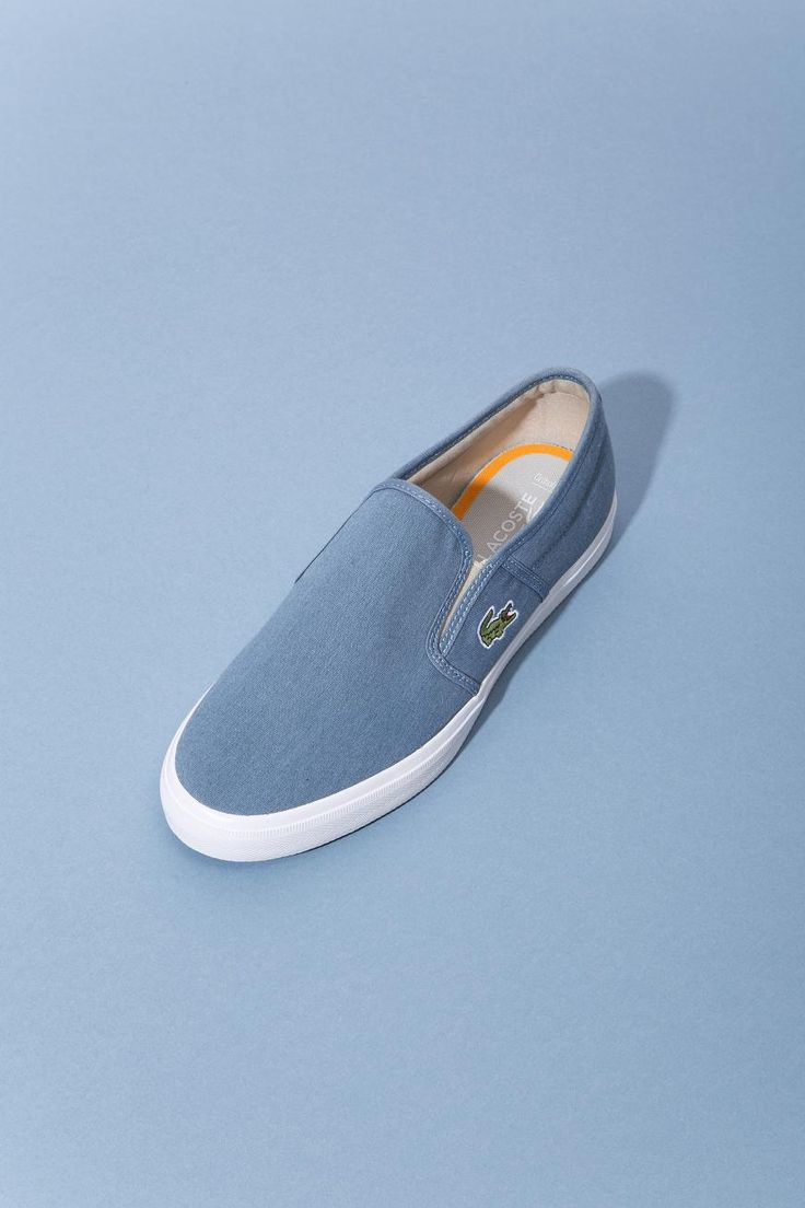 Get sporty with these easy to slip on blue Lacoste Gazon sport sneakers.