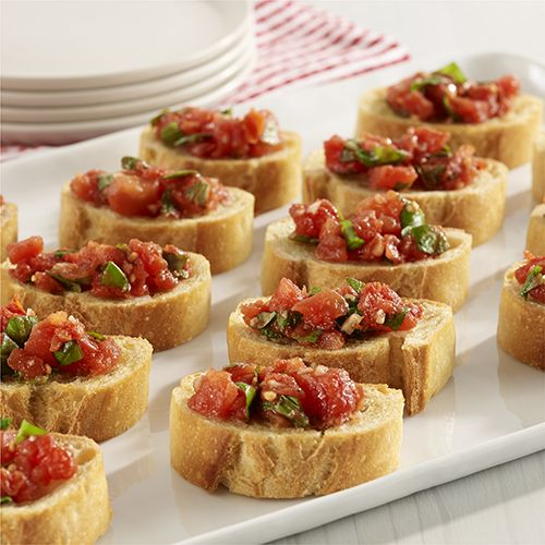 Easy Tomato Bruschetta I use way more garlic and basil but it is to your liking.