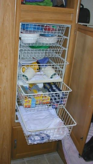 Modifications - purchase a wire drawer unit that is a perfect fit for the hanging closet even clears the shower plumbing. - Check out many more mods.