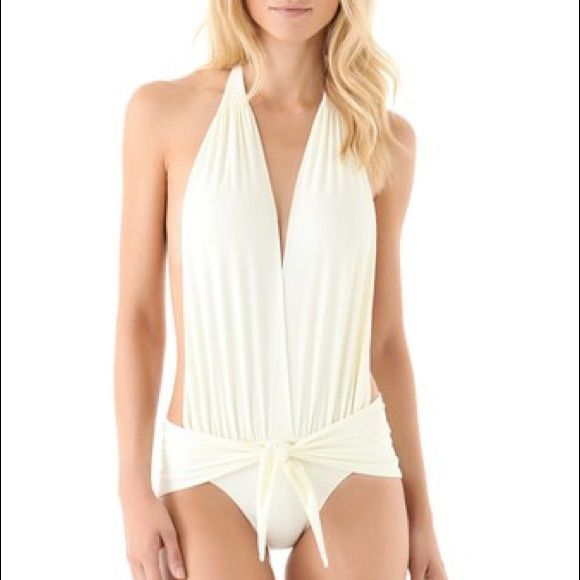Thayer Halter one piece swimsuit *FINAL PRICE* Exclusive to Shopbop.  This one-piece features a plunging V neck and an open back. Ruching and wrap tie at waist. Halter straps tie behind neck. Lined.  * 85% nylon/15% spandex. * Hand wash. * Made in the USA. Brand new. Never worn. I can't model this for you because after I bought it, I found out I was pregnant lol. RUNS SMALL. Very cheeky. best for a size 0/2. As seen on Jenny McCarthy. FINAL SALE. NO OFFERS. Shopbop Swim One Pieces