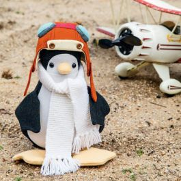 Create your own cute penguin softie complete with his aviator helmet and knitted scarf, ready for an adventure, using Jennifer Goldsmith's soft toy pattern.
