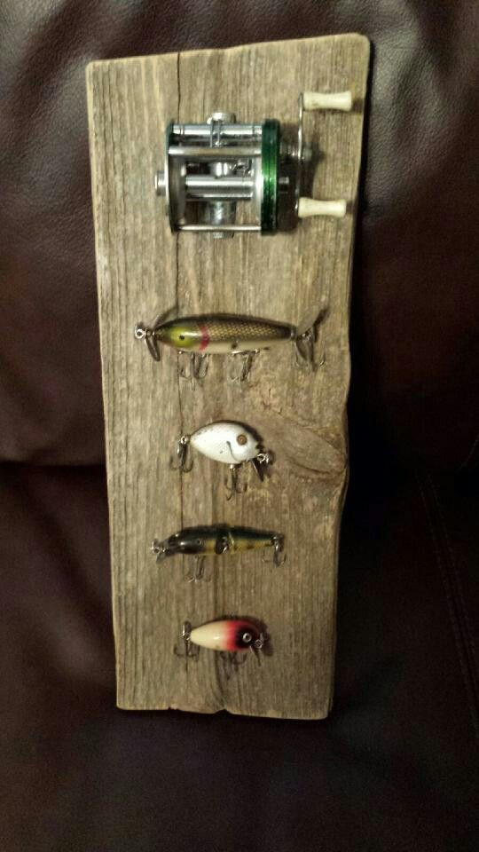 Just finished tonight...Pinterest project to display the hubby's vintage fishing lures.