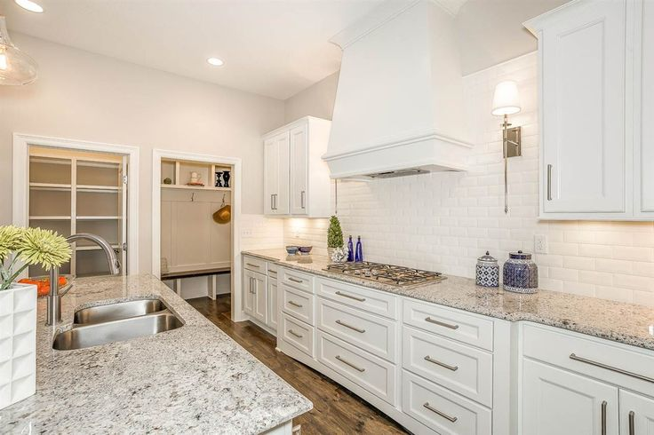 Contemporary Kitchen with Subway Tile, One-wall, Kitchen island, Ms International Moon White Granite, Pendant light