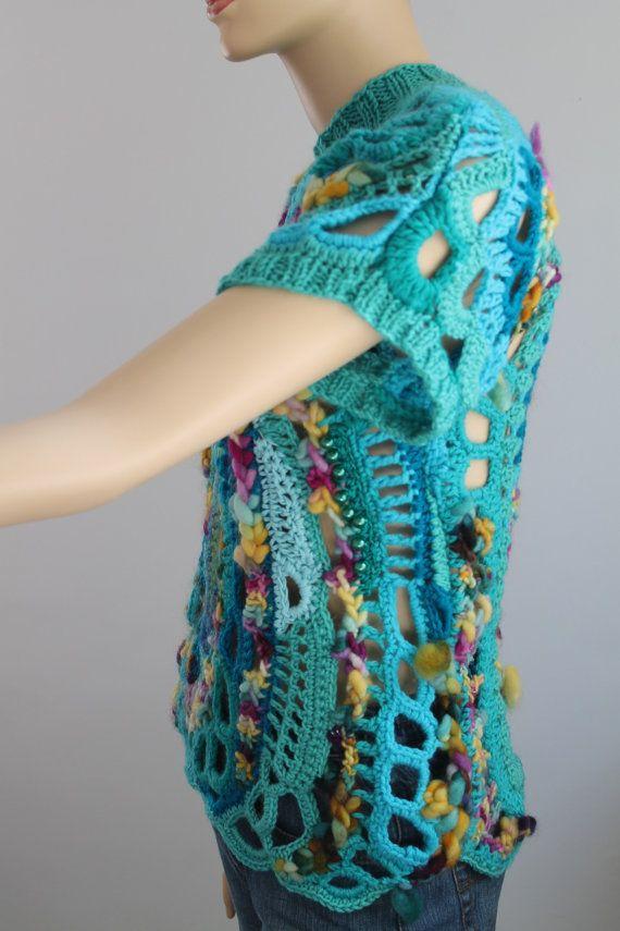 Regenboog dikke vrije gehaakte trui - tuniek - Wearable Art - OOAK Dit is een exclusieve trui, uitgevoerd in techniek Freeform. U kunt het aan beide kanten dragen. Het is een zeer warm en comfortabel. Materiaal: wol, hand gesponnen wol van de kunst, hand stierf garen, kralen, acryl, katoen. Kleur: tinten van turquoise, regenboog.  Maat: M - L Bust: 80-100 cm (34-40 inch) Lengte: 60 cm (24 inch) Zorg instructies: hand wassen zachtjes in koud water en lag plat te drogen.