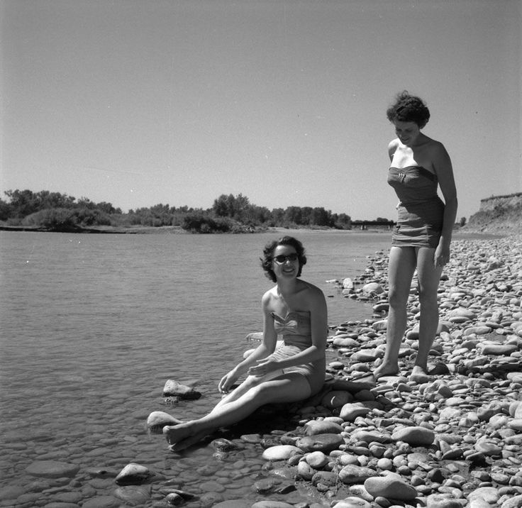 "https://flic.kr/p/wjpG46 | Audrey James and Anna Brown by the Oldman River, Alberta / Audrey James et Anna Brown près de la rivière Oldman (Alberta) | Title / Titre :  Audrey James and Anna Brown by the Oldman River, Alberta /  Audrey James et Anna Brown près de la rivière Oldman (Alberta)   Description :  Day 12 August 11, 1954 – near Fort Macleod, Alberta ""...we crossed Oldman [Old Man] River again, which was rippling over grey pebbles and looked quite irresistible. So we stopped there…"