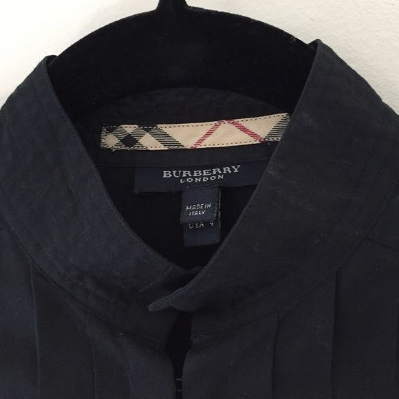 Burberry black tuxedo shirt Hipster cool luxe Burberry black tuxedo shirts. Top to bottom French hook closure. French cuffs. Size 4.  Recommend for small chested torsos Burberry Tops Button Down Shirts