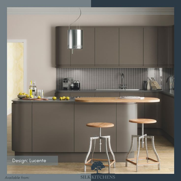 Why have just one worktop in your kitchen? This Lucente kitchen design features two – a smooth sleek grey worktop for cooking and an extra natural wood countertop for breakfast, drinks or homework.      #splashback #pulls #styling #lamp #lighting #cabinets #sink #cabinetry #kitchencabinetry #woodworking