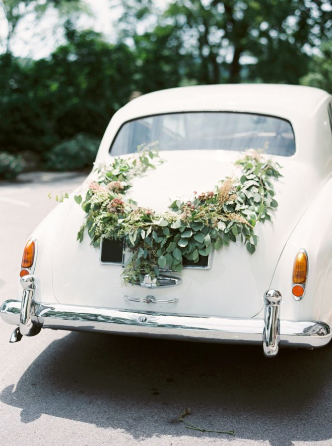 Floral draped getaway car: http://www.stylemepretty.com/vault/gallery/39441 | Photography: Cassidy Carson - http://www.cassidycarsonphotography.com/