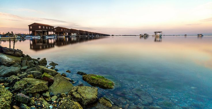 Delta's serenity | This shot was taken at Axios river delta of Macedonia Greece, where you can see the aligned mussel farmer's huts at the left of the frame. It's a two shot stitch using the same settings: