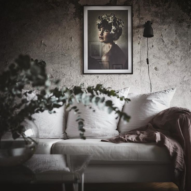 Rough and soft living room with framed poster from printler.com, the marketplace for photo art. Motif by LisaLove Bäckström. Interior design by @annafurbacken, photo by fotografanders at instagram.