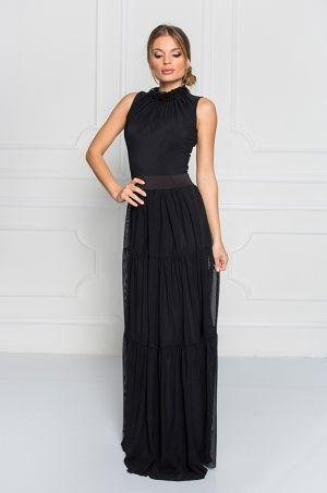 Spoločenské dlhé šaty bez rukávov s volánikami okolo krku. Šaty sú zúžené v páse s áčkovou sukňou. Vhodné na spoločenské udalosti.