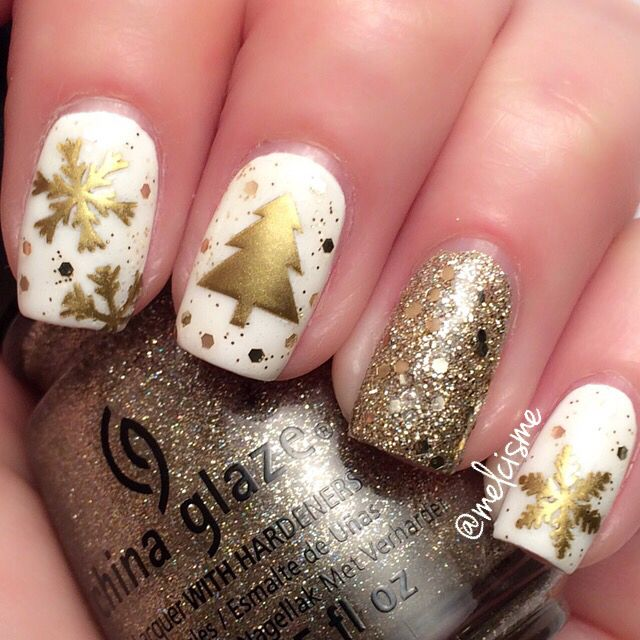 Today I received an amazing package from Kelly @nailstencils filled with a bunch of beautiful nail vinyls here I am using the #christmastree & #snowflake vinyls on top of @chinaglazeofficial White on White & I'm not lion. I also used Gold Star by Elf.