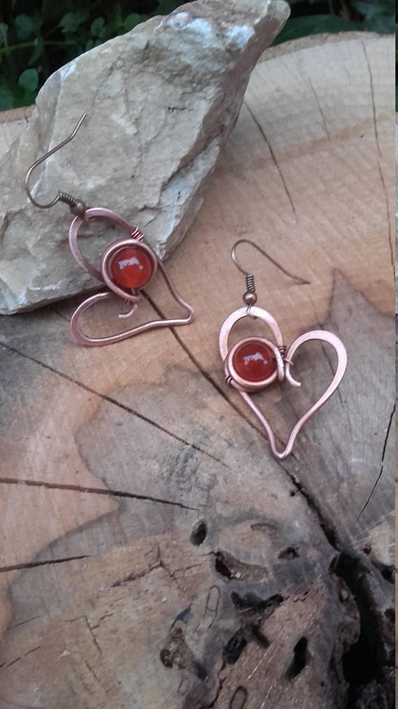 Sweet heart wire wrapped earrings Earrings are made of recycled copper wire and natural Carnelian beads. Perfect gift for her ! I you have wish to have the same earrings but with some other stone,it will be my pleasure to made it just for you :) The copper has been aged and polished to