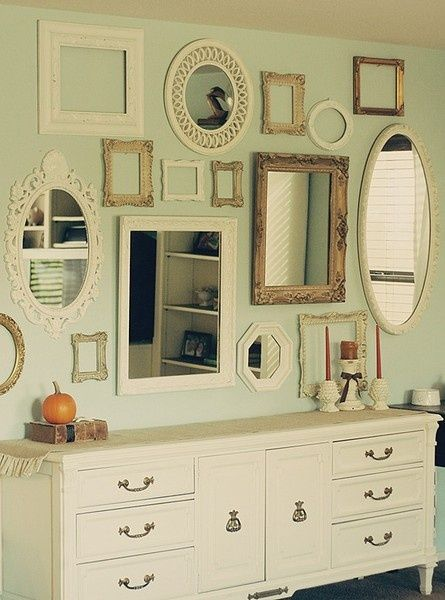 coordinating mismatched mirrors and frames as a wall collage- like our living room wall, but I love adding in the mirrors above a dresser!