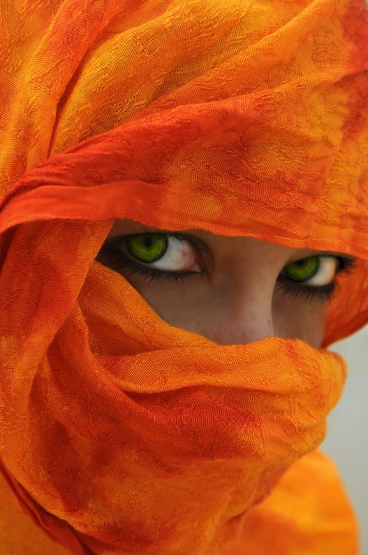 Beautiful green eyes buried in orange