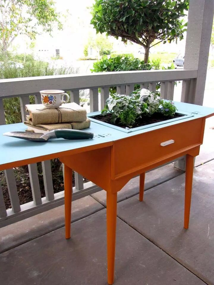 repurposed sewing machine cabinet to gardening table