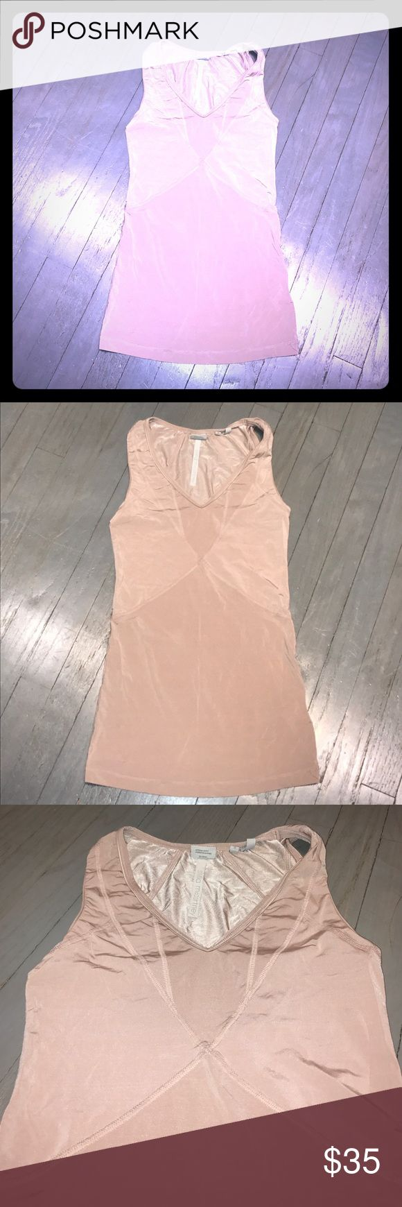 Stella McCartney for Adidas pink vneck tank top EC Stella McCartney for Adidas muted light pink dusty rose v neck sleeveless fitted workout tank top. Contour stitching throughout. Excellent condition. Matching jacket for sale in another listing Adidas by Stella McCartney Tops Tank Tops