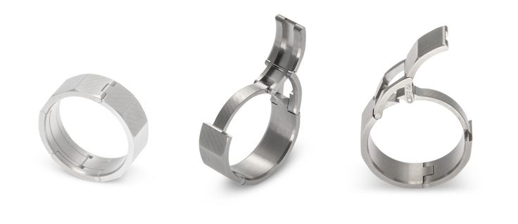 "The ""kinda trick"" gimmick of McWhinney's rings is a locking mechanism that allows the band to slip over a finger, almost like a clasp. Not only does it look cool, but it also solves a common difficulty of male wedding band design. Many men are forced to buy bigger rings than they actually want because it's the only way to slip them over their knuckles easily. McWhinney's bands, because of the clamp, are easier to put on and take off."