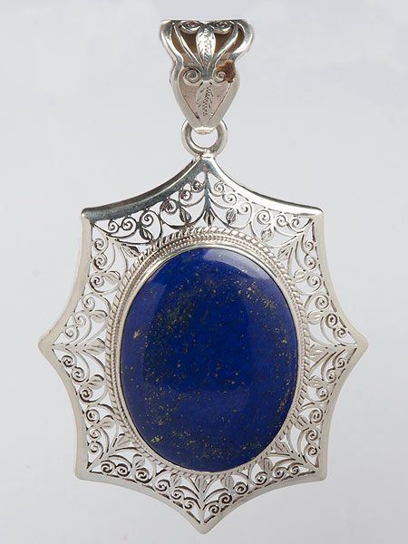 "Stunning semi precious stone inlaid silver pendant which has been crafted by hand in Nepal. This pendant is guarenteed 925 silver. Lapis Lazuli from Afghanistan. The name of this gemstone is derived from two Latin words: ""lapis""  is the Latin word for ""stone"" and ""lazuli"" is  Latin for ""blue"". Hence the blue stone. Weight 57 grams 8.5cm x 6cm"