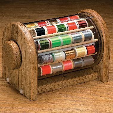 solid oak rotating Spool Safe from cabelas.com (fly-tying accessories are often fun for fiber people of any type)