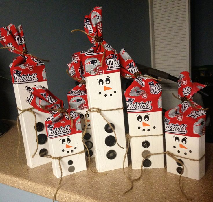 New England Patriots snowmen made from old 2x4s