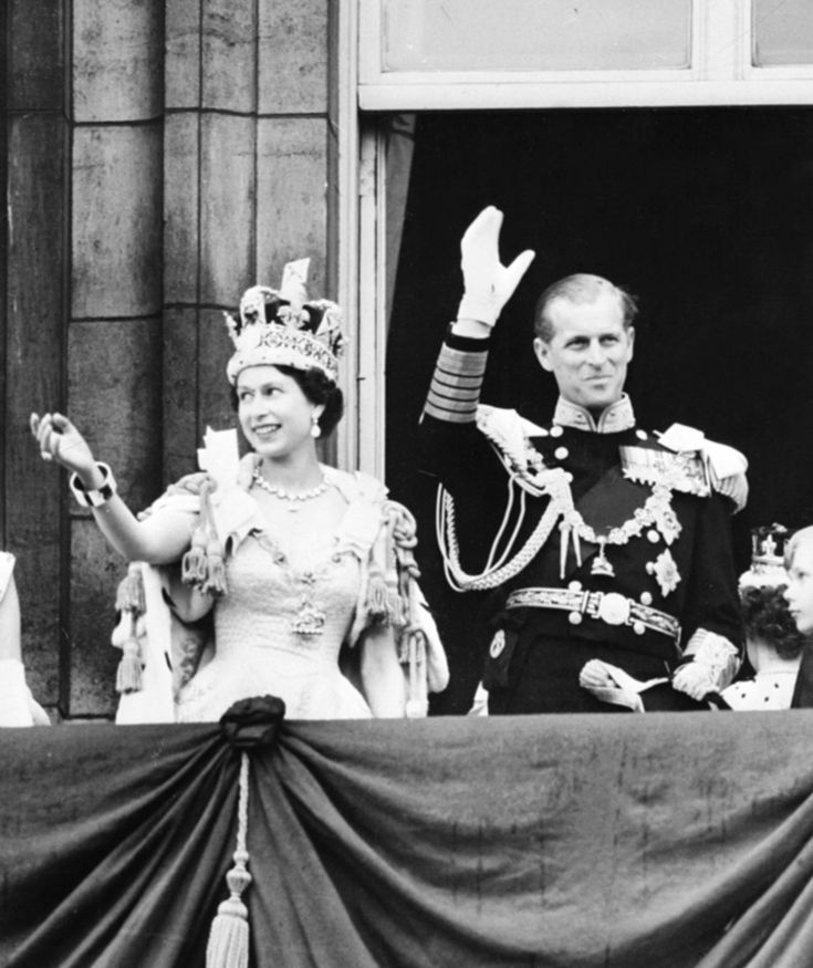 June 2, 1953 Queen Elizabeth and Prince Philip wave to the crowds below Buckingham Palace after Elizabeth's coronation