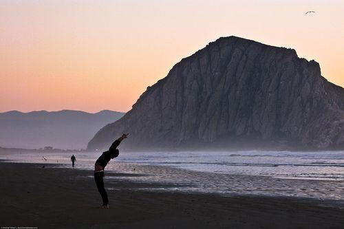 "Upward Salute – Urdhva Hastasana - Person performs mystical ""Sun Salutation"" yoga stretching exercise on Morro Strand ""Church of Kelp"" by mikebaird, via Flickr"