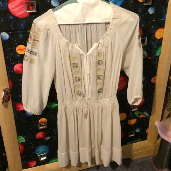 Embroidered Festival Dress Beautiful cream colored embroidered dress. Comes with nude slip. Tag says size 2 but fits better as a size 6 Club Monaco Dresses