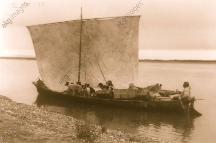 Arriving home – Noatak, 1929 Eskimo and dogs in sailboat.