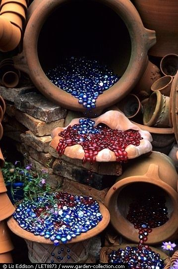 Glass pebble fountain.  Love this idea.  After having a pond, I no longer want the high electric bill running the pump.