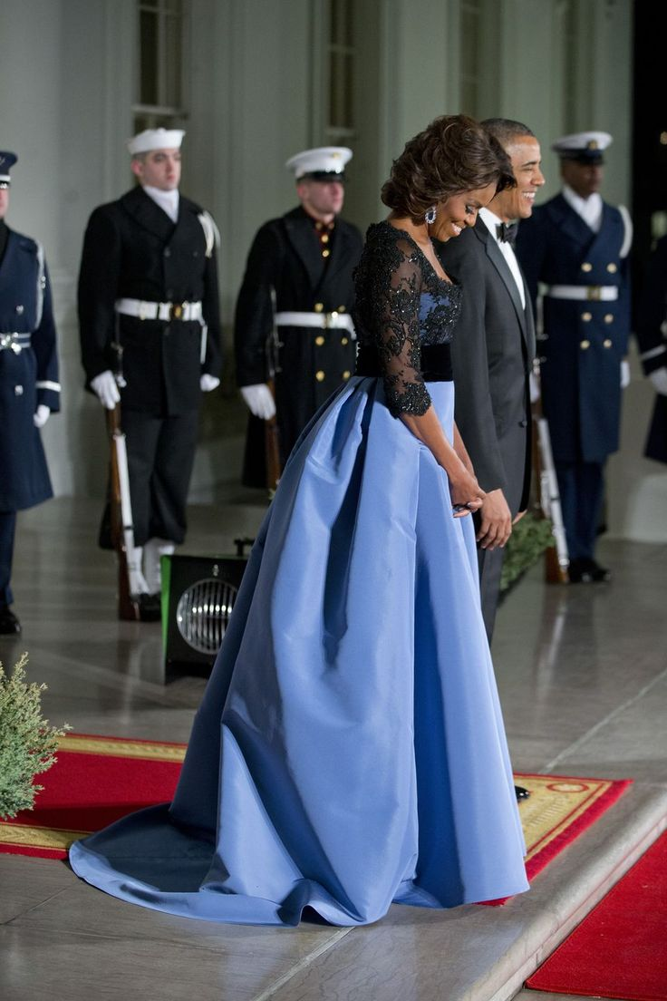 First Lady in a gorgeous dress. State dinner for French president, Feb. 2014. Dress by Carolina Herrera