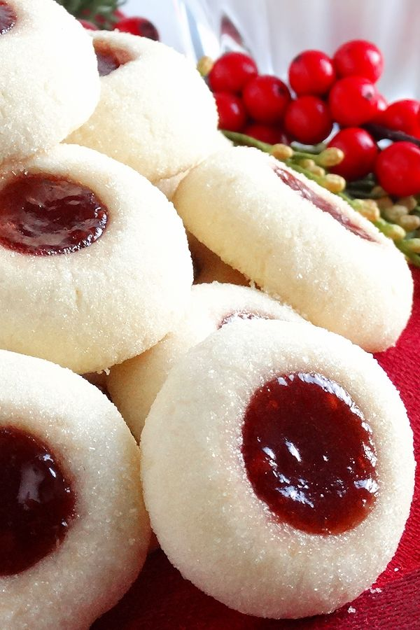 Melt-in-your-mouth classic jam thumbprint cookies, Grandma's Perfect Jam Thumbprint Cookies, filled with both raspberry and strawberry jam and perfect in every way—just the way Grandma made. Buttery, tender-crumbed, sweetened just right and perfect for the Christmas holiday. In fact, the Christmas cookie tray wouldn't be complete without them. Included is a scrumptious and irresistible gluten …