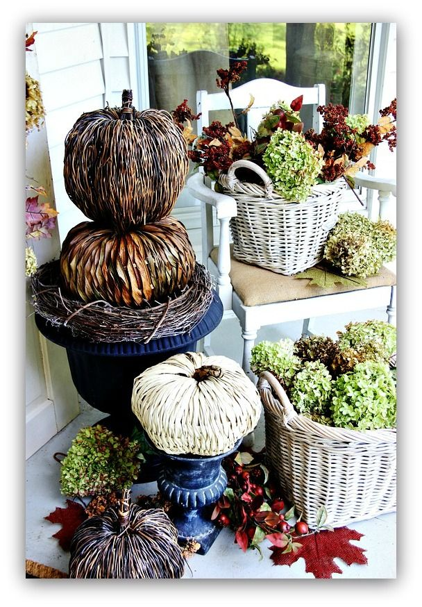 Add dried hydrangea in baskets for an easy, free way to decorate your front porch.  Tuck pumpkins into urns and add leaves on the ground.  thistlewoodfarms.com