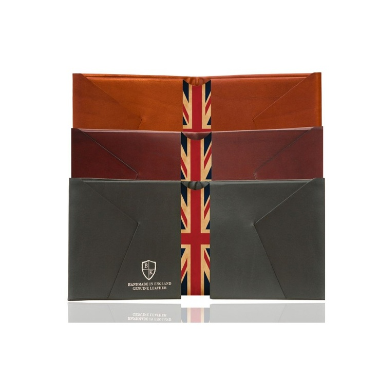 Bond & Knight - Union Jack - inspired by a 1940's vintage origami design technique Bond & Knight wallets are made using a single piece of folded leather, with no stitching and no seams giving them a unique look. The leather centre piece of this design features an antique faded Union Jack flag, with the Bond & Knight trademark matching colour corner in red and super soft black suede lining. Bond & Knight wallets are super slim but hold 10 cards comfortably plus full length notes section.